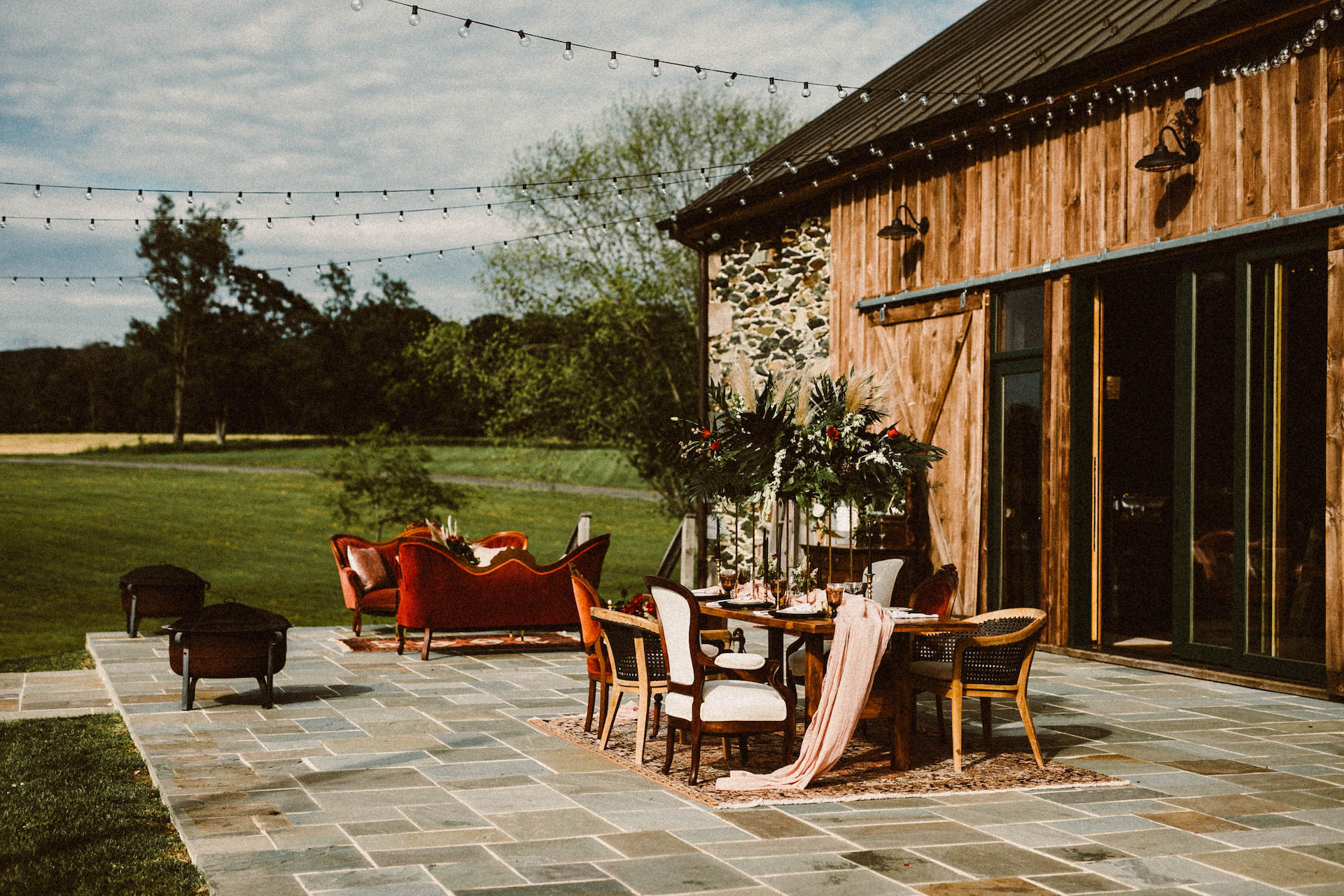 Barn stone patio with staged furniture on it